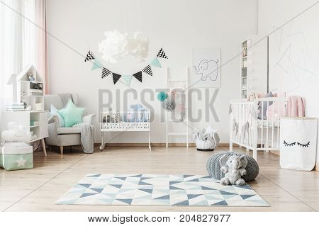 Spacious Kid's Room With Banner
