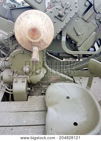 Details Of A Second World War Gun Placed On Top Of Vintage Tank