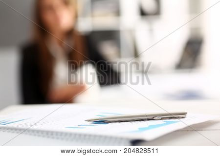 Silver Pen Lying On Important Paper At Table