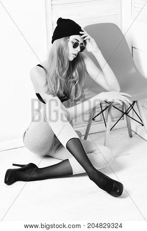 Pretty Sexy Woman In Sunglasses, Bra, Hat At Orange Chair