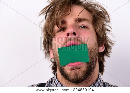 Man Holds Dark Green Card In Mouth.