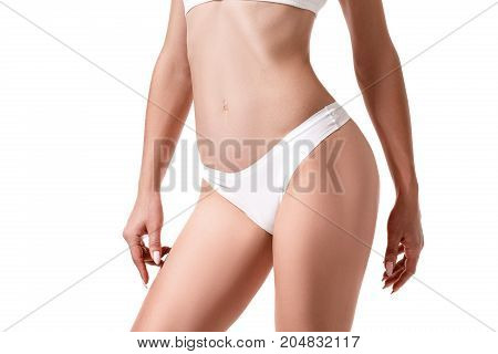Perfect female body isolated on white background. Sport. Health. Concept plastic surgery