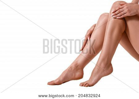 Long pretty woman legs, isolated on white. Healthy lifestyle, sport, healthcare, nutrition and diet concept. plastic surgery
