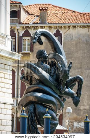 Venice, Italy - May 18, 2017: Sculpture by Damien Hirst outside the Palazzo Grassi next to the Grand Canal. Damien Hirat`s new exhibition opened in Venice in April 2017.