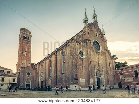 Venice, Italy - May 17, 2017: The Basilica di Santa Maria Gloriosa dei Frari. This old famous church was built in the 14th century and is tourist attraction.