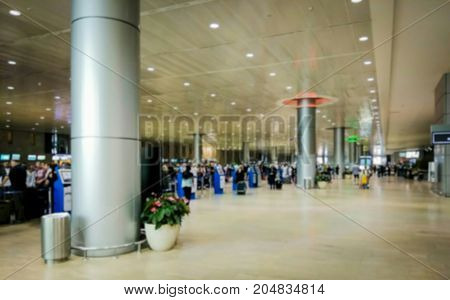 Blured view of departure hall at large international airport. Check in zone