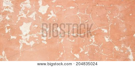 Blank old painted plaster wall with cracked texture background