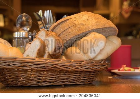 Breakfast bred basket on the table with brown background