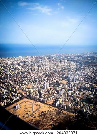 View of Tel Aviv and the Mediterranean Sea from the window of the plane taking off from the airport Ben Gurion
