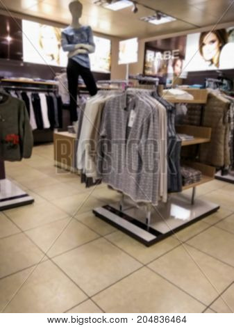 DUSSELDORF GERMANY - AUGUST 17 2017: Blured view of interior of small fashion clothing store at Nord steet at northen part of Dusseldorf