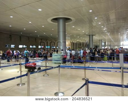 Blured view of departure hall of international airport. Check in zone