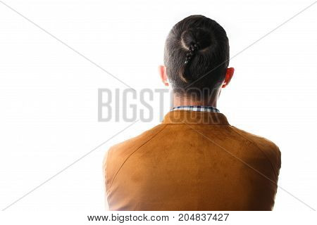 Photo from t back of man with pigtail on head in jacket isolated on white background