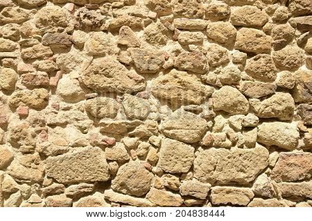 Stone wall in the medieval village of Pals located in the middle of the Emporda region of Girona Catalonia Spain.