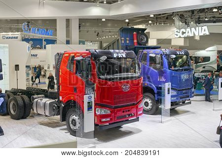 MOSCOW, SEP, 5, 2017: Close up view on Chinese FAW trucks exhibit on Commercial Transport Exhibition ComTrans-2017.FAW commercial transport on exhibition stand Commercial dump trucks Chinese cars