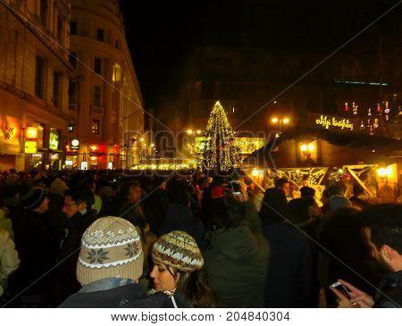 Budapest, Hungary - January 01, 2016: Tourists enjoy the Christmas market in centre of Budapest, Hungary on January 01, 2016