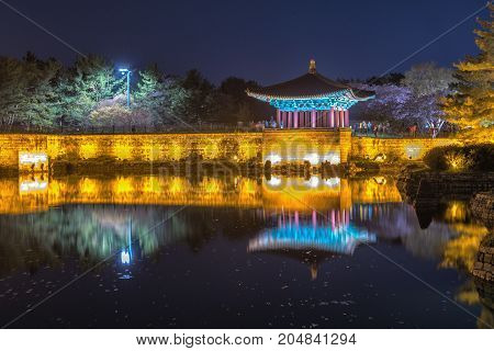 The pavilions of Anapji Pond lit up as evening comes on in Gyeongju South Korea