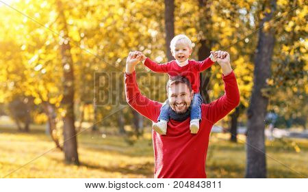 happy family father and baby son playing and laughing on autumn walk