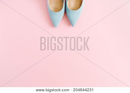 Fashion blog look. Pastel blue women high heel shoes on pink background. Flat lay top view trendy beauty female background.