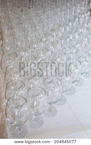 Wineglasses before fourchette clear and crystal. Selective focus
