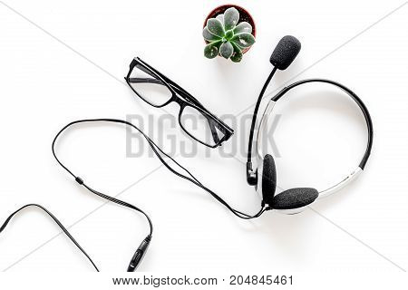 Call center manager's accessories. Headphones on white background top view.