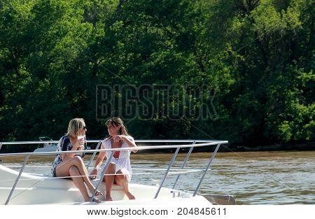 Washington DC - April 30. 2011: Two young women relaxing on the sailing boat in Washington DC