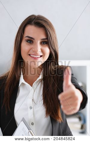 Beautiful Smiling Woman Showing Ok Or Approval Sign