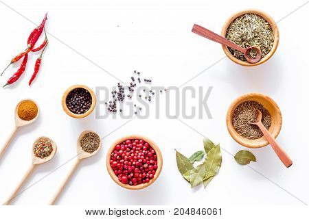 Spicy food cooking with spices and dry herbs on white kitchen desk background top view mock up
