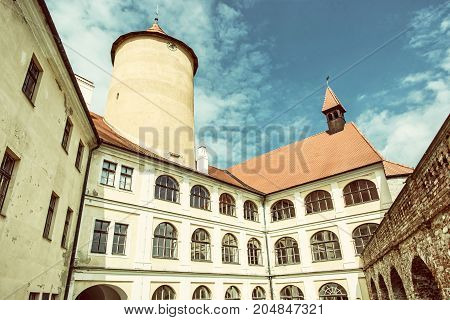 Courtyard of Veveri castle Czech republic. Ancient architecture. Travel destination. Old photo filter.