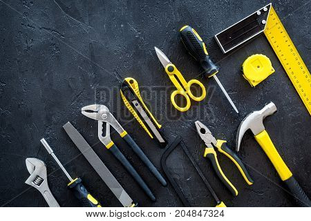 set of tools for build and repair house on dark desk background top view mock-up