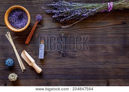 natural cosmetics with lavender and herbs for homemade spa on wooden table background top view mock up