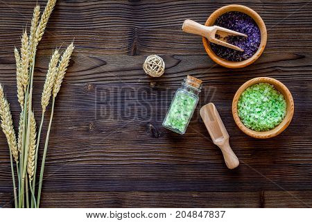 organic cosmetic set with wheat herbs and sea salt in bottle on wooden table background flat lay mockup
