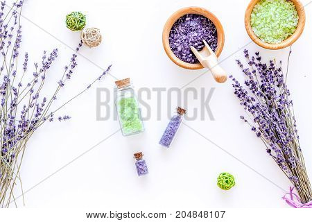 natural cosmetics with lavender and herbs for homemade spa on white table background top view
