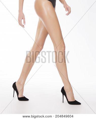Walking caucasian girl in black shoes, anonymous shot