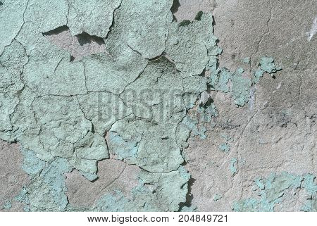 concrete wall with old plaster chipped, chipped paint, background texture