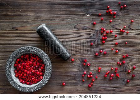 close up of ingredients for making spices and herbs in mortar on wooden background top view