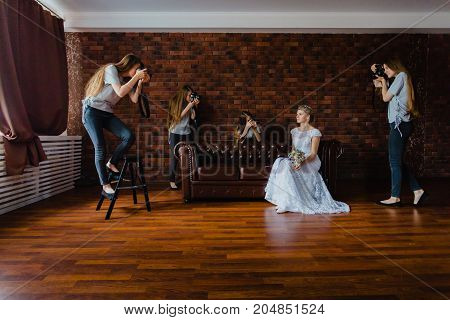 Hallucination of a bride with four same photographers after long hard photo session