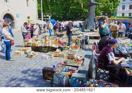 Lviv, Ukraine - May 6, 2017: The stalls of the flea market in Museum square offer different goods - old medals, toys, books, vinyl records, on May 6, 2017 in Lviv.