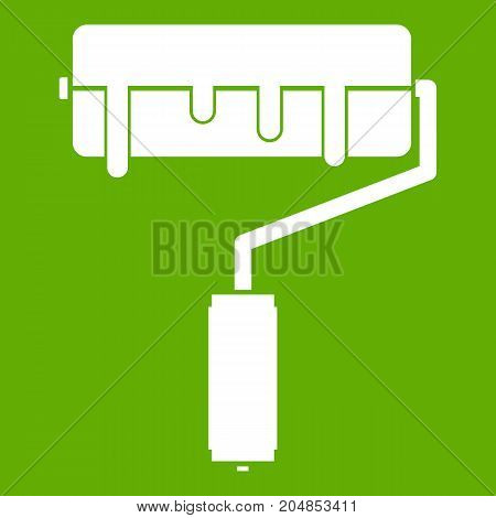 Paint roller with paint icon white isolated on green background. Vector illustration