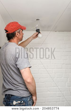 worker making repairs in a city apartment