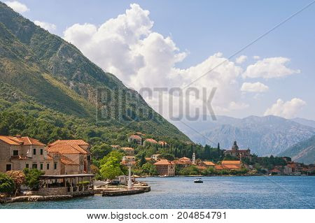 View of Kotor Bay and Prcanj town on a summer day. Montenegro