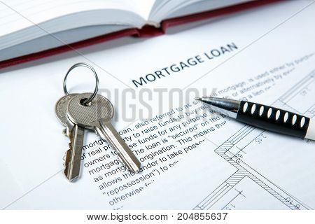 apartment keys apartment plan mortgage loan document and pen