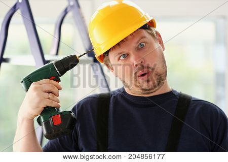 Idiot Worker Using Electric Drill Portrait