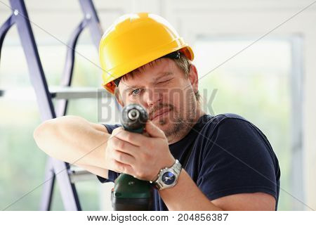 Worker Using Electric Drill Portrait