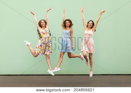 Three Happy Excited Young Adult Women
