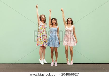 Pretty Young Woman's Jumping And Hands Up, Have Fun.