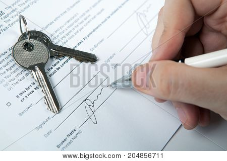 apartment keys apartment plan mortgage loan document and a human hand