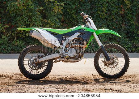 Green Cross Motorcycle. Dirt bike on a photo shoot. Training motocross bike.