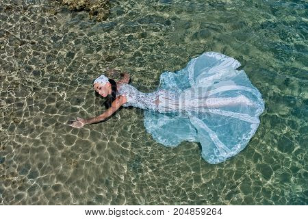 Bride On Sunny Summer Day On Seascape