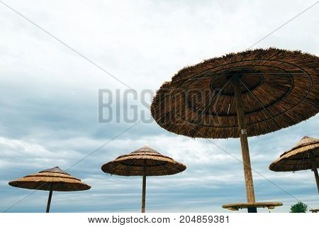 Rest on the seafront. Colorful wooden beach chairs with sun umbrella