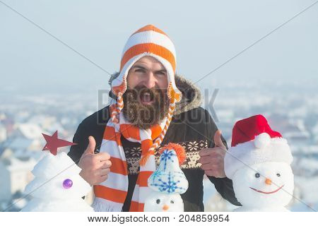 Man Giving Thumbs Up With Snowy Sculptures